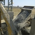Komatsu_HD785_truck_dumping_ore_into_crusher_at_Phoenix_Nickel-1.jpg